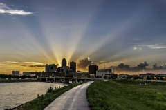 sun rays behind downtown Des Moines